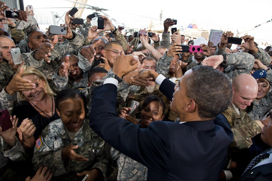Obama shakes hands and snaps pictures with troops at Fort Bliss. Read more: http://www.businessinsider.com/obama-campaign-photos-2012-9?op=1#ixzz2aV4Z2K00