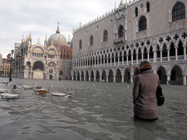 Scientific research indicates sea levels worldwide have been rising at a rate of 0.14 inches (3.5 millimeters) per year since the early 1990s. The trend, linked to global warming, puts thousands of coastal cities, like Venice, Italy, (seen here during a historic flood in 2008), and even whole islands at risk of being claimed by the ocean. Photograph by Andrea Pattero/AFP/Getty Images