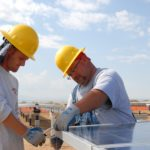 construction workers working with solar panels